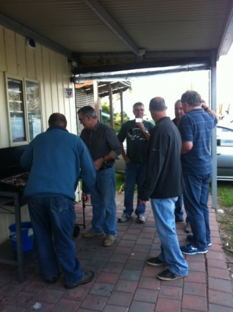 How many men does it take to cook a BBQ???